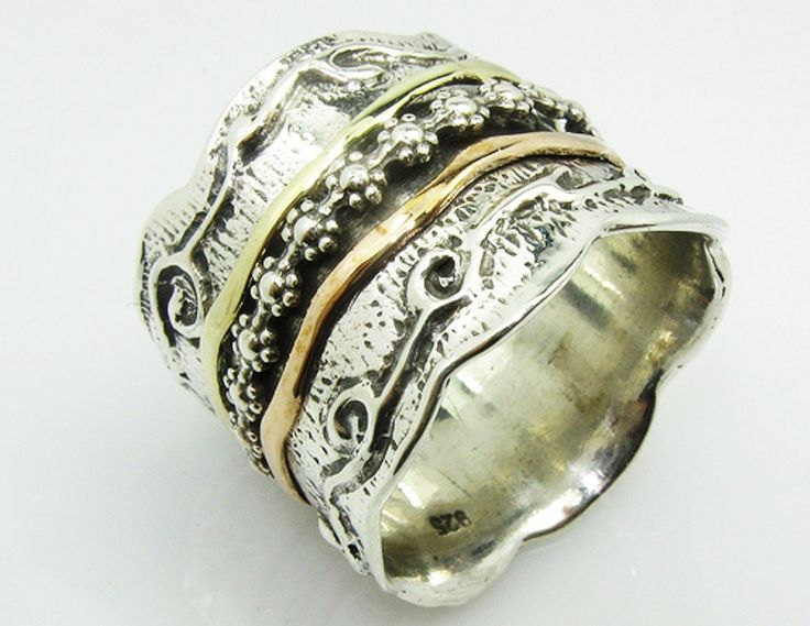 israeli spinner rings with jewish writing and precious stones