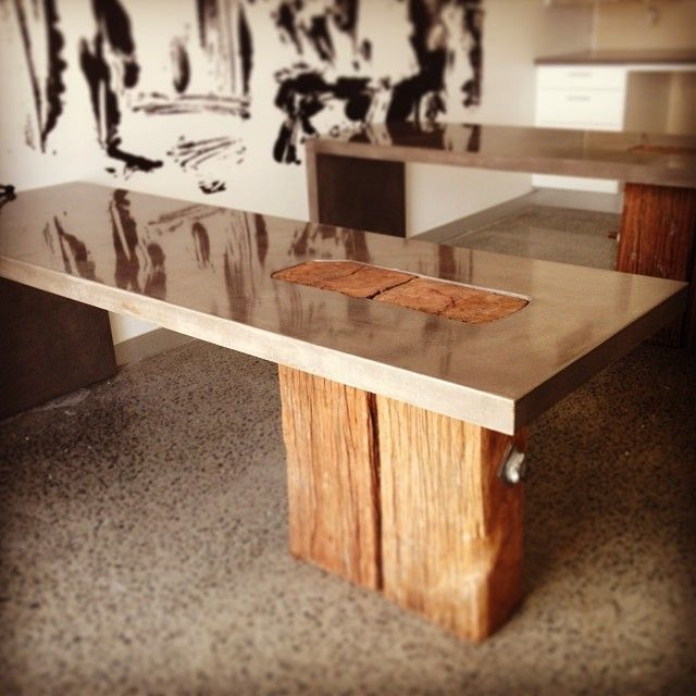 Integrating timber and concrete. These client produced the timber, we produced the benchtop! by POPconcrete