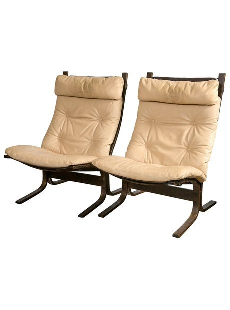 "These ""Siesta"" chairs depict the finest in Scandinavian design with tufted rare to find tan leather on a curvaceous rosewood frame with sling cushions. 