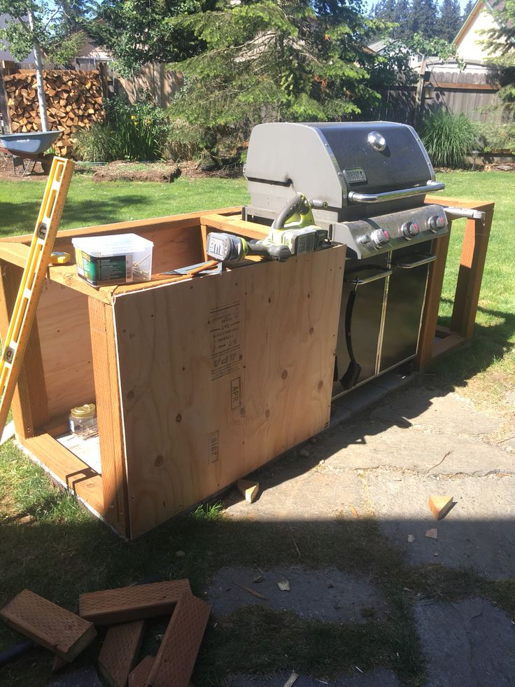Adding plywood to the BBQ station