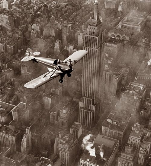 Flight Over Midtown, February 28, 1937 --  Ted Herbert of Roosevelt Field takes a spin over midtown Manhattan in a new type of sport plane powered by a V-8 automobile engine. From the New York Times Photo Archives.