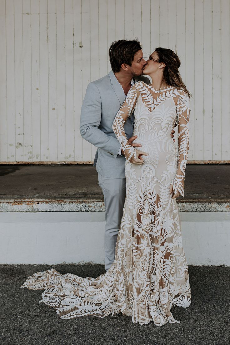 pregnant bride in long sleeve lace wedding dress by Rue de Seine