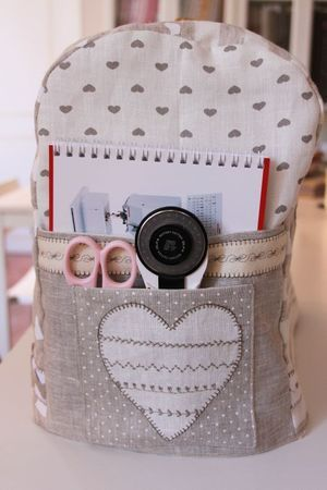 cute sewing machine cover. Like the neutrals and the use of decorative stitches on the pockets and trim. Ric-rac. Twill tape.