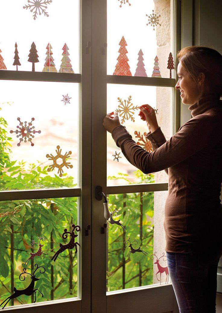 Decorando las ventanas  Cristales decorados con siluetas con motivos navideños de La Cuillère de Sucre.