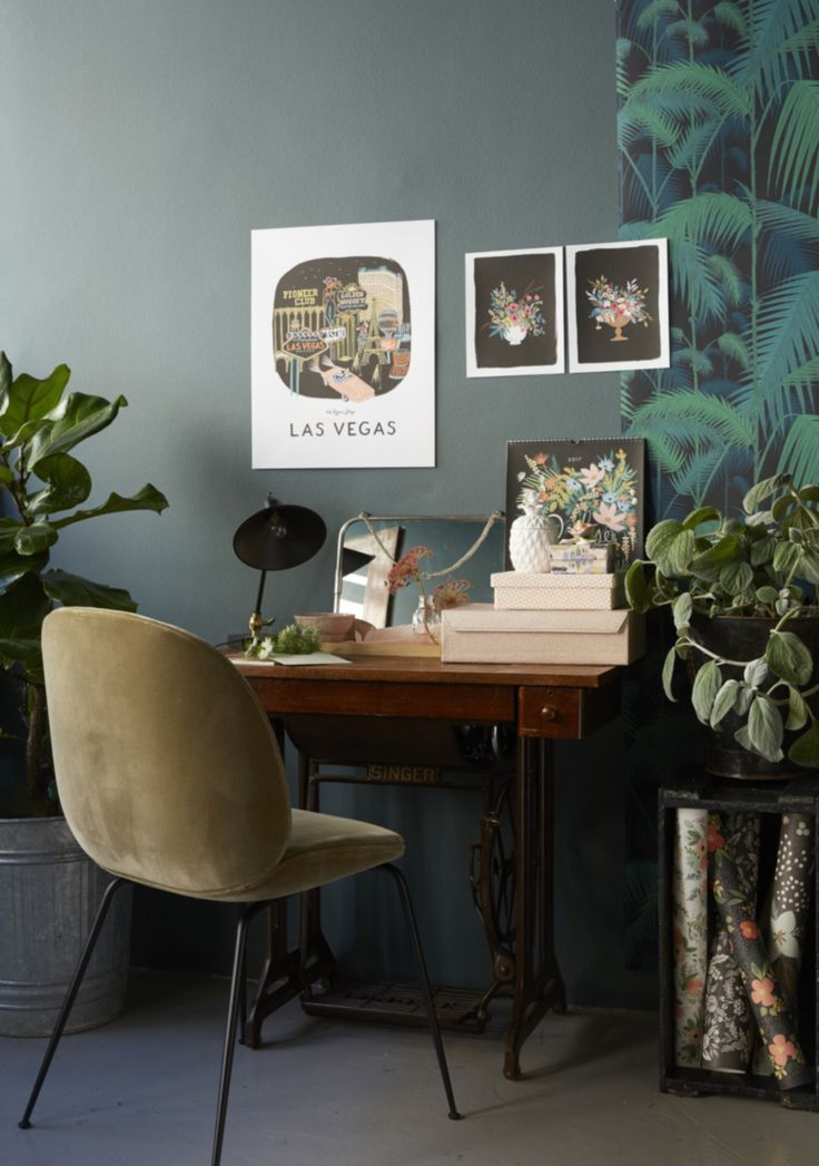 A natural workspace with plants and botanical prints
