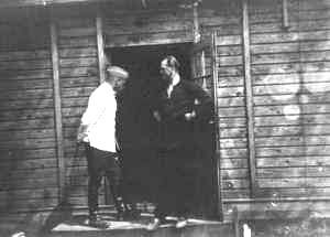 Camp commander Franz Stangl visiting Kurt Franz, who replaced him later. The photo shows the entrance of the commander's barrack, one of the two SS barracks or perhaps the barber's barrack.