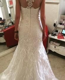 Amie Boughen's breathtaking dress using our Karma Ivory Embroidered Lace.