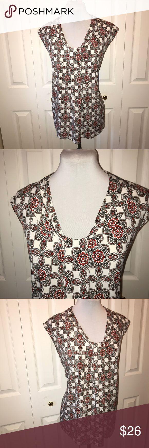 "Dana Buchman Sleeveless Tunic Top Mandala Print XL Dana Buchman Sleeveless Tunic Top Mandala Print XL Measurements taken Unstretched Bust: 46"" Waist: 45"" Hip: 48"" Length: 25"" Dana Buchman Tops Tunics"