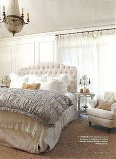 love the tufted headboard and that chair