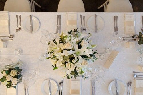 White Wedding. Roses. Lilies. Centre Pieces.