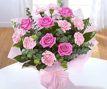 The bright and sunny arrangement to create a glowing smile on anyone's face Online Flower delivery. The combination of chrysanthemums, solidage and gerberas is crafted by the florist to create a perfect gift for any occasion
