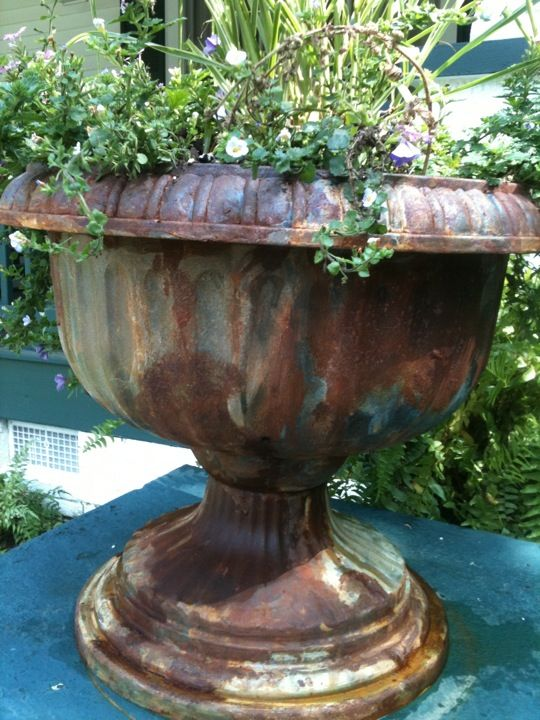 Rusted and Patina'd planters at Random Arts in Saluda.One would never know that these were once cheap plastic pots from the dollar store.