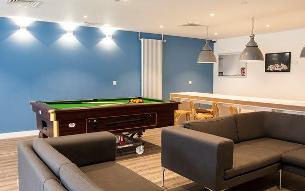 Another side to our common room with seating areas and pool table.
