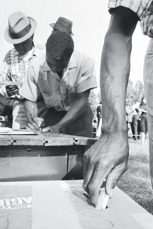 African Americans vote in Alabama in 1966, in the wake of the Voting Rights Act.  (Photograph © Flip Schulke/CORBIS)