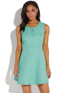 02a198115ed A sleeveless textured fit and flare dress with a round neckline.