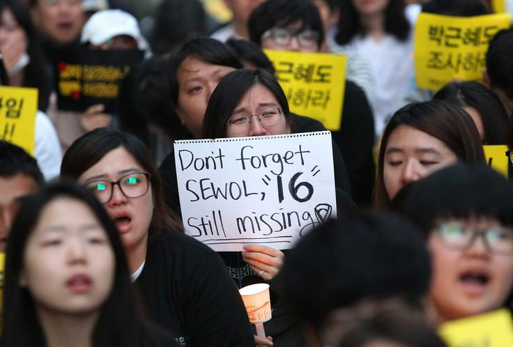 A college student weeps during a rally to demand the government to seek the truth in poor handling of the sinking of the ferry Sewol, in Seoul, South Korea, Saturday, May 24, 2014. More than 300 people are dead or missing in the water off the southern coast in the disaster that caused widespread grief, anger and shame.