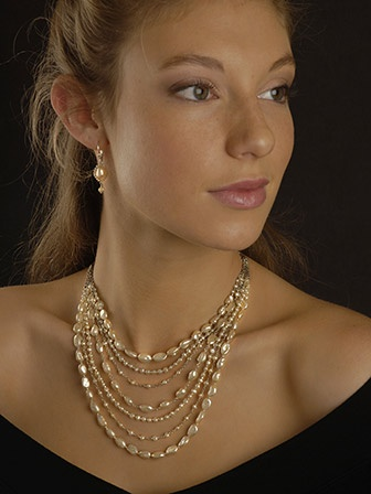 A multi strand of creamy baroque pearls and leather tie-back...so elegant and beautiful