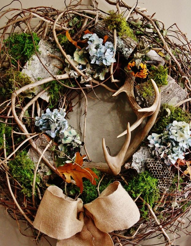 antler wreath.  I'm in love with all the natural elements woven  through this gorgeous wreath -- even the hornet nest combs!