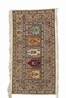 SILK TURKISH RUG, MODERN, Signed in the upper left corner Approximately 2 ft. 4 in. x 4 ft. 5 in. (71 cm. x 135 cm.)