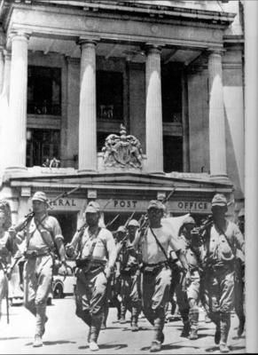 Japanese soldiers parading through the streets of Singapore. The fall of Singapore to the Japanese Army on February 15th, 1942 is considered one of the greatest defeats in the history of the British Army and probably Britain's worst defeat in World War Two. The fall of Singapore in 1942 clearly illustrated the way Japan was to fight in the Far East – a combination of speed and savagery