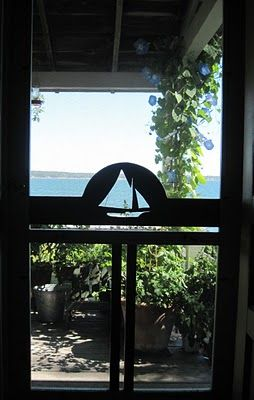 My favorite screen door from the Wooden Screen Door Company in Waldoboro, Maine. This shot is from our living room out to John's Bay.
