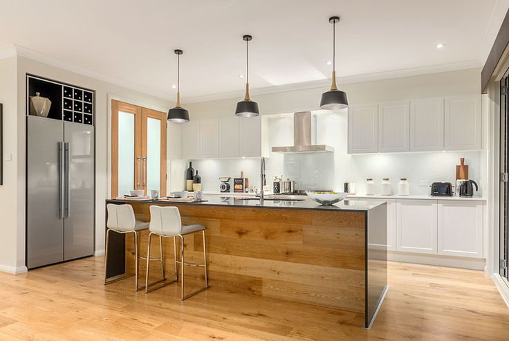 Love the floorboards in the kitchen of our Miami on display in Jordan Springs. The timber features simply flow up the side of the island bench...creating a stunning, endless visual! For details see http://mcdonaldjoneshomes.com.au/display-home-locations/jordan-springs #kitchen #gourmetkitchen #pendantlights #lighting #stone #benchtop #timber #floorboards #flooring #islandbench #inspo #design #décor #kitchendesign