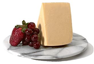 Wensleydale cheese -Traditional, hard cheese made from cow's milk. It has a shape of cylinder with natural rind. Wensleydale can be used as table cheese and is very tasty with apple pie.