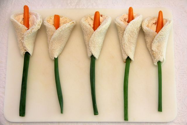 Lily Sandwiches - the original recipe is here http://catholiccuisine.blogspot.com/2008/03/lily-sandwiches.html BUT    It looks like it is time to update that post with a few tips and a couple new pictures...   This year I used some Garden Vegetable Cream Cheese & green onions for the stems!