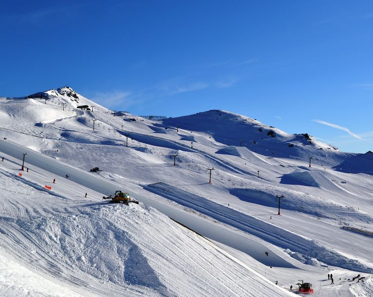 Pushing snow for the big air in august 2014. Another perfect bluebird day to shred the pipe or parks up at Cardies! #ski #snowboard #nz