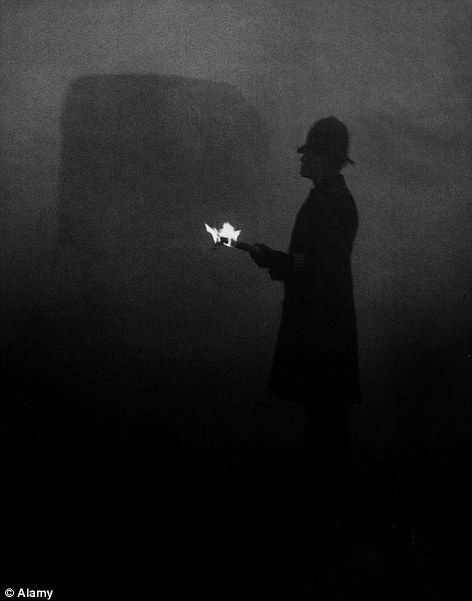 The Great Smog of London of 1952: A police officer using flames at Marble Arch to direct the traffic in London smog in 1952