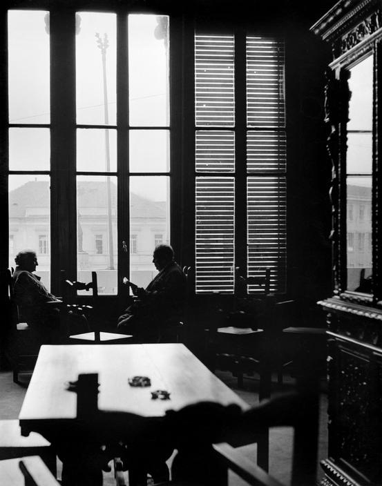 Herbert LIST :: Casa Verdi (retirement home founded by Guiseppe Verdi). Seated in the window of the library are the pianist Concette Abte and the tenor Giovanni Banbancioni. / Milano, Italy, 1950