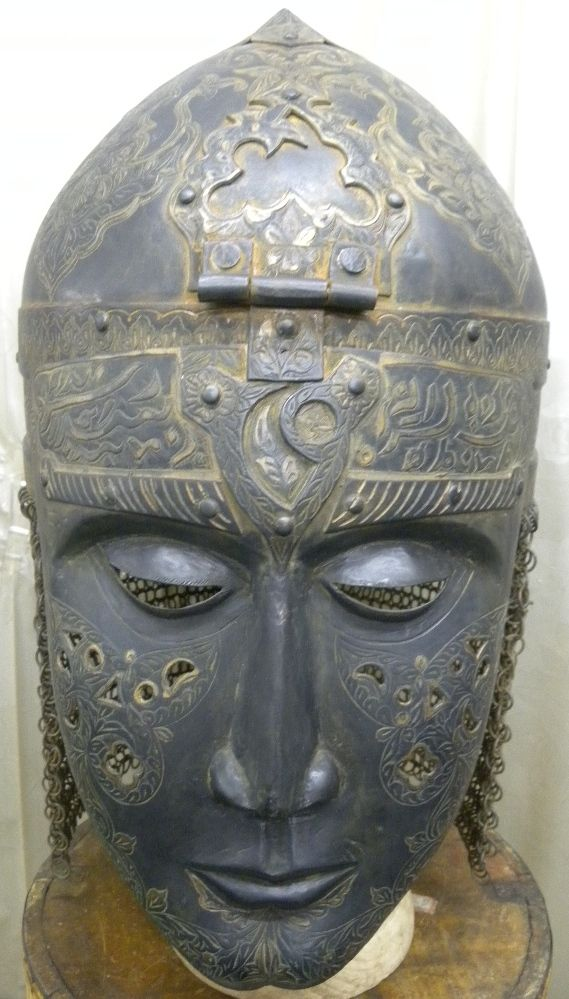 ORIGINAL OTTOMAN TURKISH ISLAMIC EMPIRE BATTLE WARRIOR HELMET/ [TC/280] Authentic Ottoman / Turkish Islamic empire Curio collection rare exquisite helmet with mask, this makes this very rare and unique warrior helmet to find. On the forehead of mask and bottom rim band of helmet has hand chisel Arabic pious calligraphy from Islamic holy book Koran to invoke God's power and blessing to win battle.