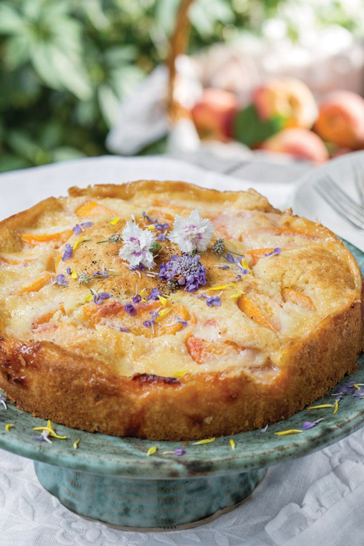 This Peach Kuchen is a special treat with a delicious Custard Cream and beautiful edible flowers.