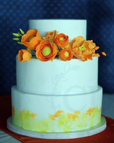Torta ranúnculos naranja y acuarela