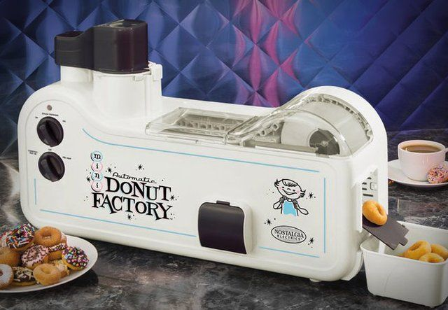 Automatic Mini Donut Factory - it reminds me Homer Price by Robert McCloskey  =)