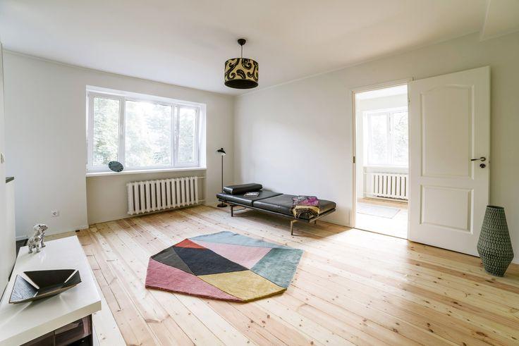 Designer apartment with original restored wooden floors by Larsen Kinnisvara at North-Tallinn, Estonia.