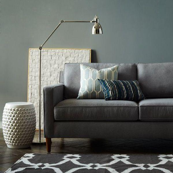 Grey couch, grey wall.