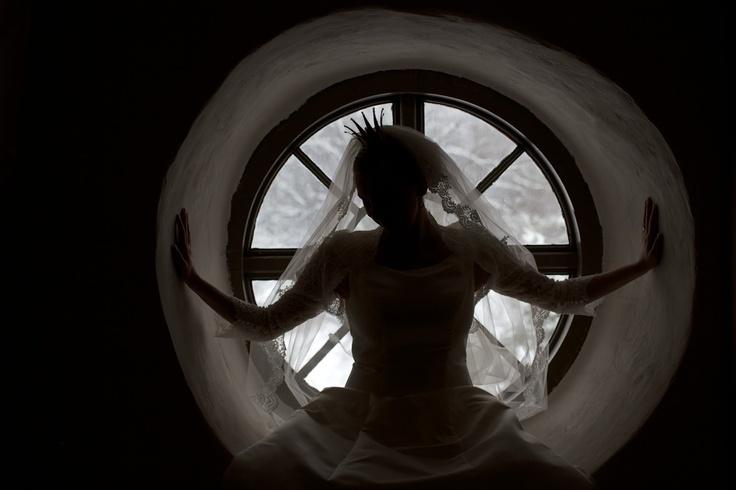 Bride silhouette against a round window.  Brudporträtt mot runt förnster.  Köla, Värmland