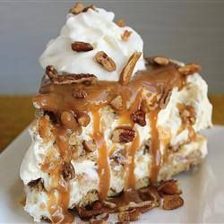 2 cups rough chopped pecans, 2 cups flaked coconut (optional),  1 stick butter,  8 oz. cream cheese softened, 1  14 oz can condensed milk,  16 oz cool whip,  1 jar caramel ice cream topping,  2 graham cracker crusts