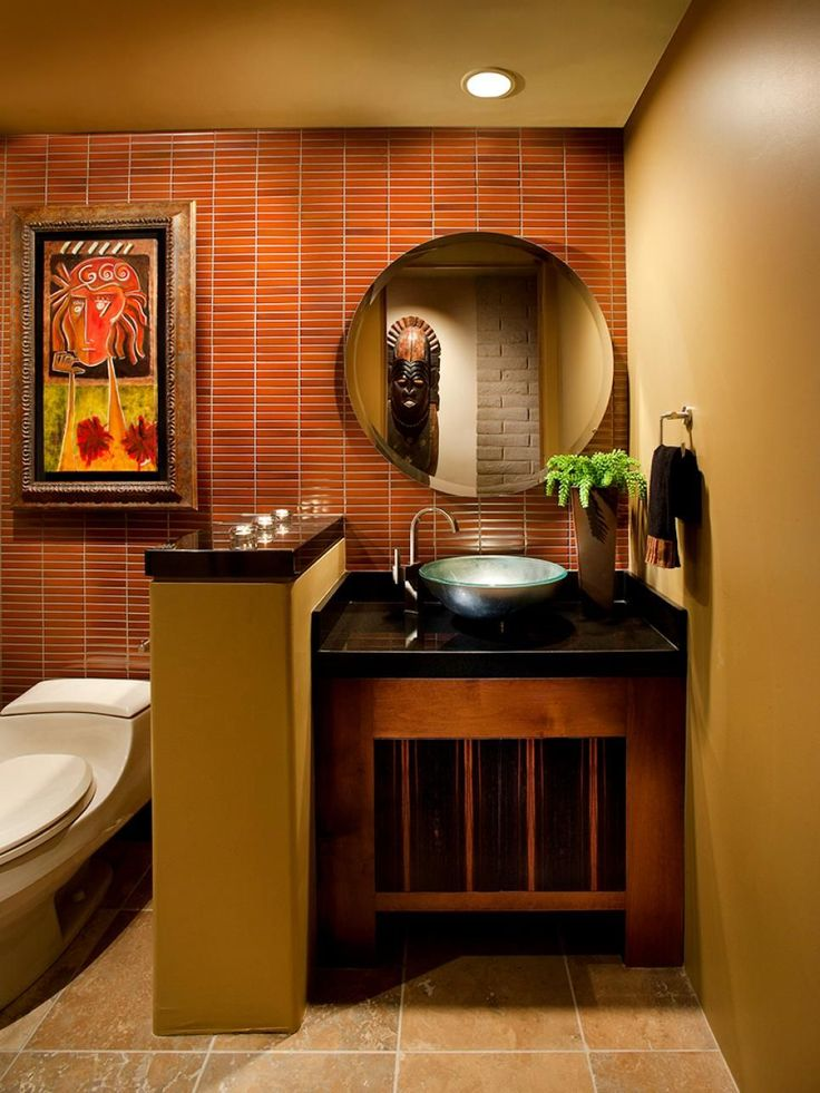 A+red+tile+wall+warms+up+this+contemporary+bathroom+while+adding+visual+interest+and+serving+as+a+focal+point.+The+round+mirror+and+vessel+sink+help+soften+the+space's+otherwise+sharp+edges.