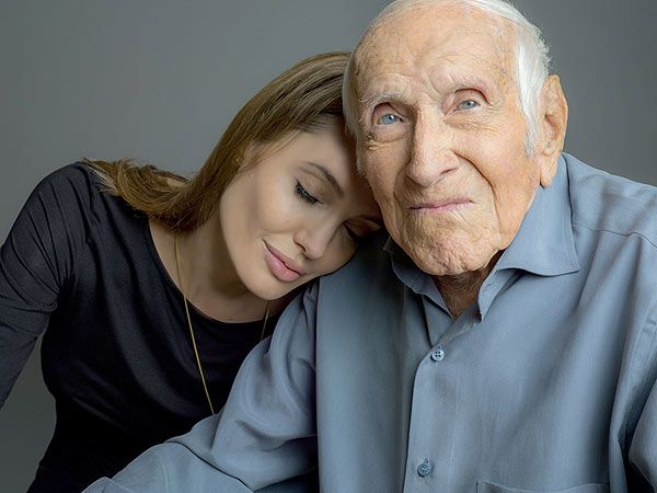 Angelina Jolie met Louis Zamperini, the 96-year-old former Olympic runner and World War II prisoner of war, last winter when she signed on to direct Unbroken, based on Zamperini's life. The pair became fast friends.