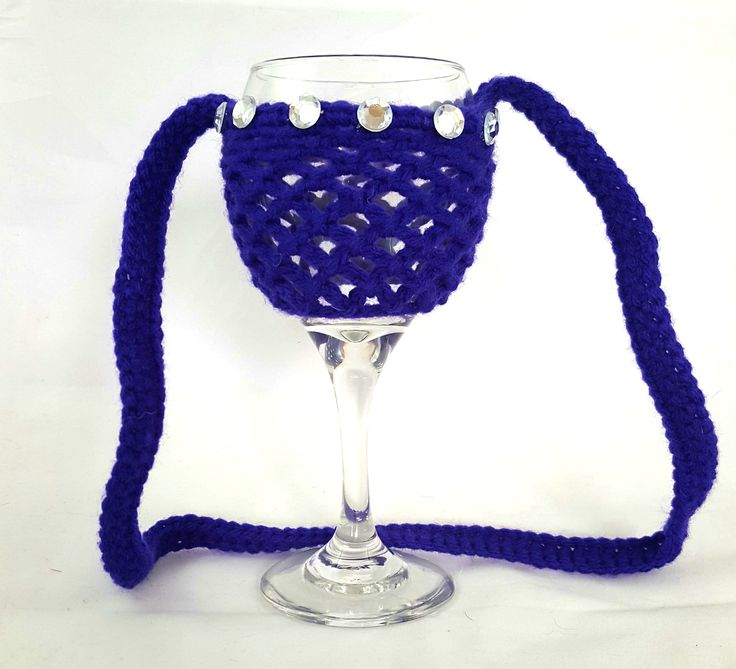 This wine glass necklace is perfect for the wine enthusiast! Fantastic stocking stuffer idea! Great for girls night out, bachelorette party, wedding favor, wine festivals, barbecues and more. No more worry about which wine glass is yours. A lovely crochet wine glass holder that sits nicely on the table or around your neck. Made in colors of your choice, one color or many colors. Created with 100% acrylic for stability and comfort.