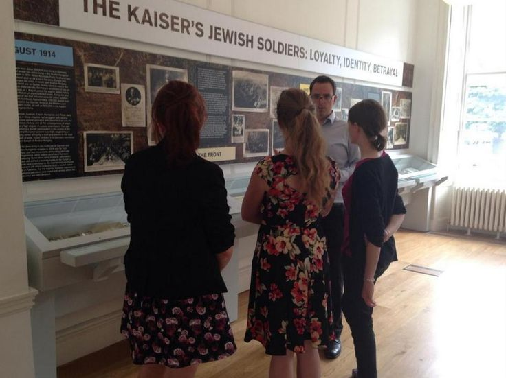 Day 1 - Natalie, Hannah and Maddy are shown round the Library's World War One centenary exhibition by the curator, Dr Toby Simpson.