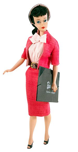 Fashion Designer Barbie, 1960  Barbie has had over 100 career changes throughout the years, but one of her first jobs was designing dresses. Fashion Designer Barbie wore a tailored pink suit and carried her portfolio to meetings