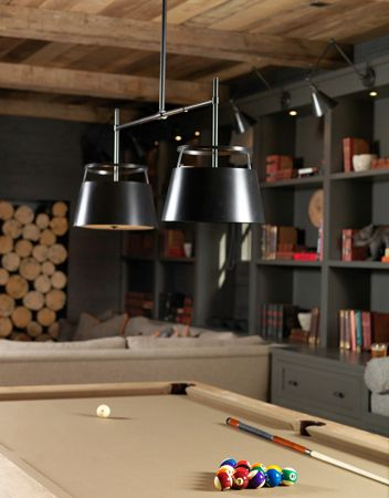 What a beautiful pool table room.  I'm crazy about the color of the pool table and how it reads so well with the celing, but on the vertical plane, the grays and blacks are so rich and masculine.  I'm in love.  I'm in love!  ~mkw