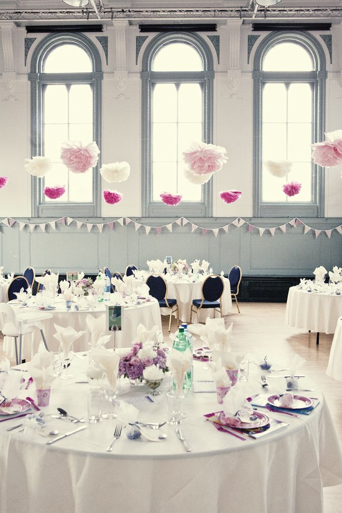 Make tissue paper flowers in your wedding colors, then hang them from the ceiling or from windows are varying heights to add depth and a pop of color to your wedding space.