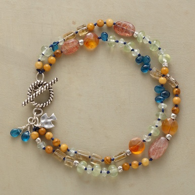 """ROPE OF MANY COLORS BRACELET -- Stones of many kinds and colors—labradorite, moonstone, topaz, peridot, coral, citrine, neon apatite, yellow jasper, carnelian among them—shimmer and shine up and down double-stranded ropes. Toggle closure. Exclusive. 7-1/2""""L."""