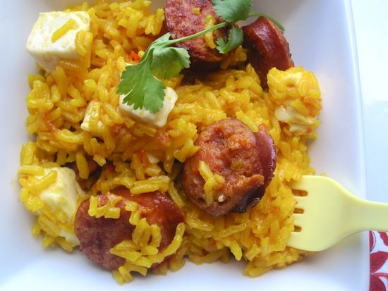 Arroz Clavado (Rice with Smoked Sausage and White Cheese)