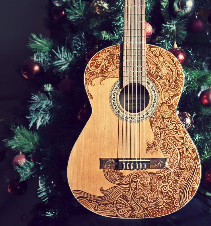 Totally buying a guitar just so I can draw on it....and possibly teach myself how to play.