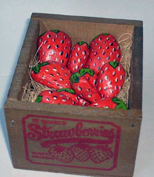 I just love these ... pebbles painted to look like strawberries!